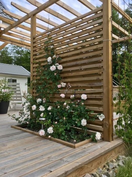Deck garden Backyard pergola Pergola Backyard garden Patio garden Garden landscaping - 25 Fascinating DIY Backyard Pergola Ideas for a Cozy Home - #Deckgarden ...tal look is created by using layered tiles. It looks quite stylish. That way you get a total cover plus shade. Yet it won't have the looks of a gaze...o covers are varnished to make the patio look shining. To ensure that the patio remains free of splinters carpenters often sand its edges to make the #gallery.fanniehansen.com #garden-pat