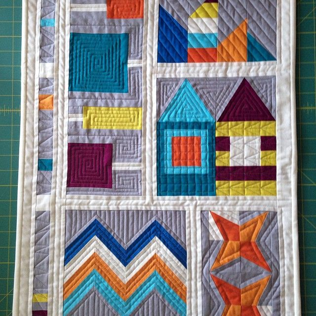 """My finished #patchworkcity mini. This was for the #dmqg Quiltcon mini challenge."""