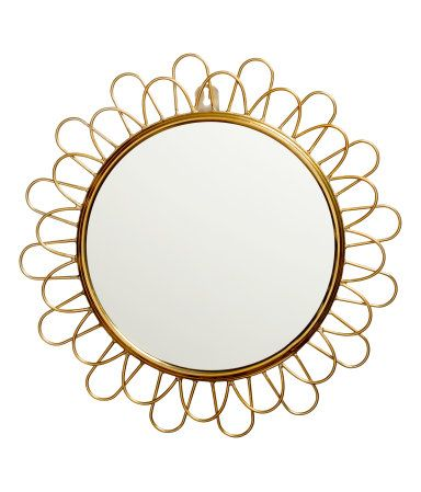 sunburst style round mirror with a gold tone metal frame h m gifts h m gift guide. Black Bedroom Furniture Sets. Home Design Ideas