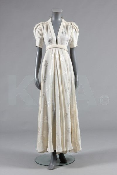 Ossie Clark ivory damask 'Bridget' dress, early 1970s, labelled 'Quorum', with plunging neckline, wrap-over skirt with knife-pleated side panels