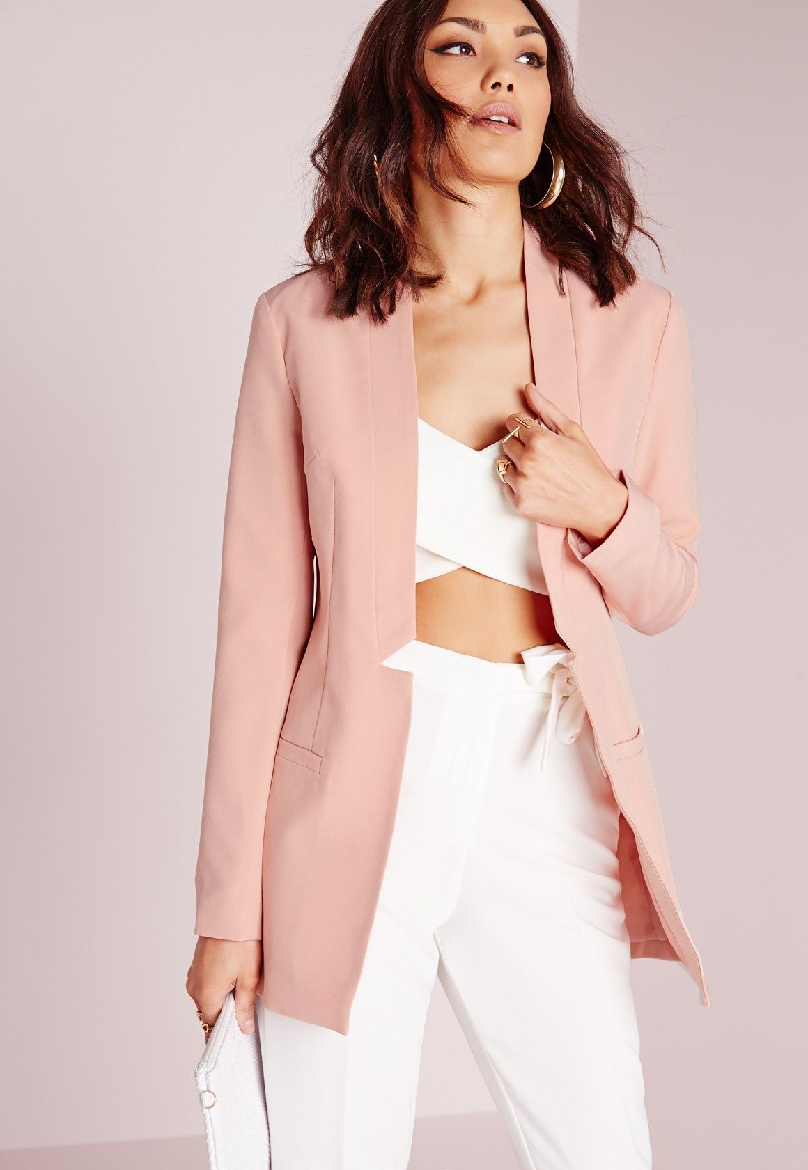 13dd11936b8c Step back into the 80s in this longline blazer in light pink