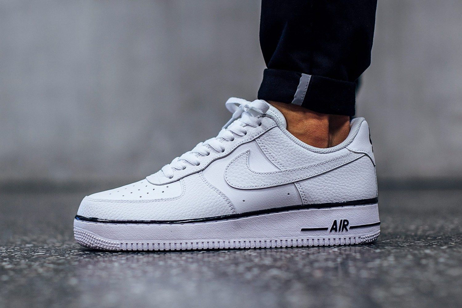 new styles 6d6d4 3de81 Nikes Latest White Air Force One Sports a Dash of Black