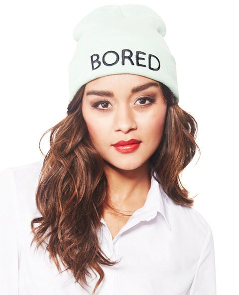 """<p>On those days when you're just feeling """"blah,"""" at least you can express yourself with a funky accessory in this roll cuff beanie. It has a solid ribbed knit body with the word """"Bored"""" embroidered across the front of the adjustable roll cuff.</p>  <ul> <li>100% Acrylic</li> <li>Imported</li> </ul>"""