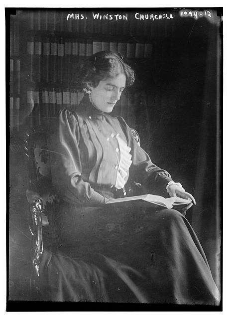 """Clementine Churchill seated with book. Churchill once said, """"My most brilliant achievement was my ability to be able to persuade my wife to marry me."""""""