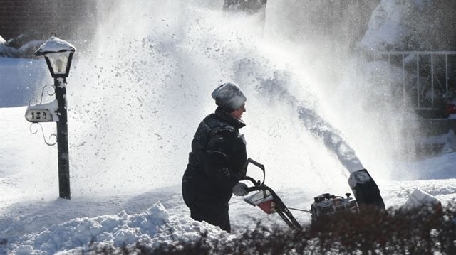 Up to 30 centimetres of snow fell on some areas of Kitchener and Waterloo in an overnight storm that caused widespread closures and treacherous driving conditions on Monday.