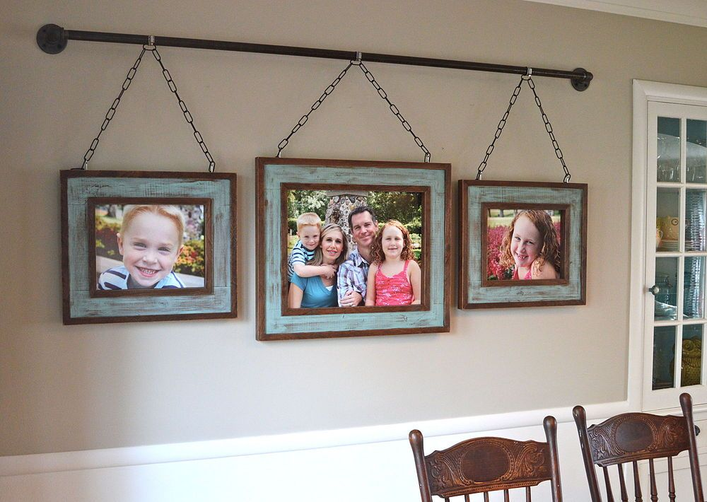 I Like The Idea Of Using A Curtain Rod To Hang Photos Iron Pipe Family Photo Display After Building Rustic Picture Frames Out Some S Lumber