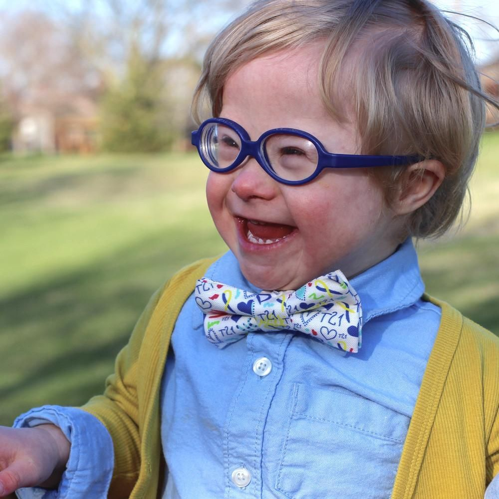 Beautiful child in blue glasses wearing Down Syndrome Awareness Bow Tie. #bowtie #child #joy