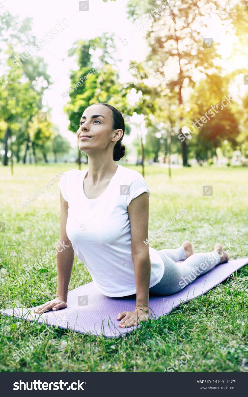 Slim fitness woman on a yoga mat to relax outdoor in park #Sponsored , #AD, #woman#yoga#Slim#fitness