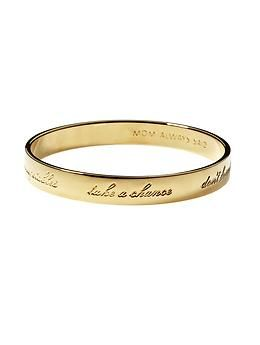 """Outer edge of bangle is engraved with """"take a chance, don't forget to floss, have courage, wear sunscreen, eat your vegetables"""""""