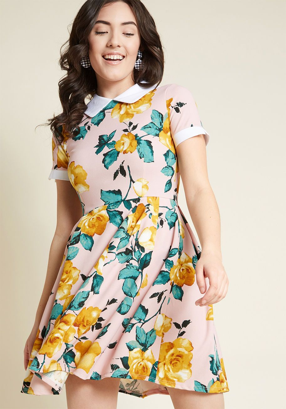 5e8fc01970 The crisp white collar and matching cuffs, mustard floral print, and  pocketed skirt of this pink dress from Smak Parlour all collaborate in  sweet sartorial.