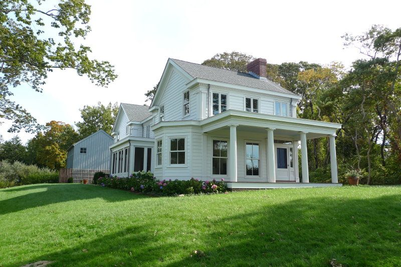 Greek Revival Farmhouse Plans The Custom Mahogany Door Sits Next To Floor To Ceiling Double Hung