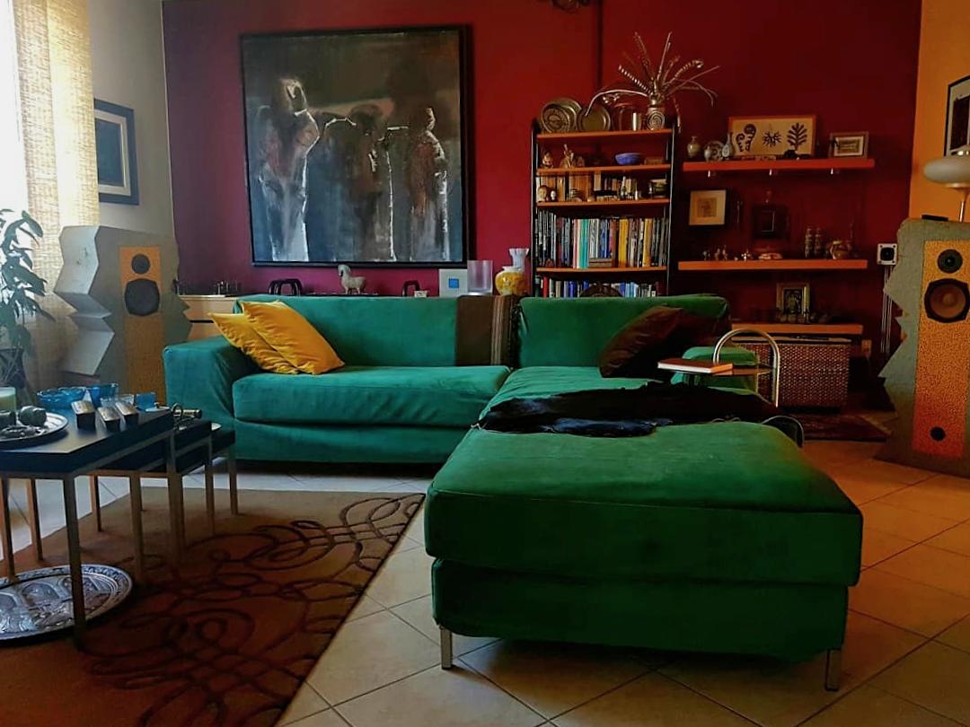 Comfort Works' Rouge Emerald, dark green velvet sofa