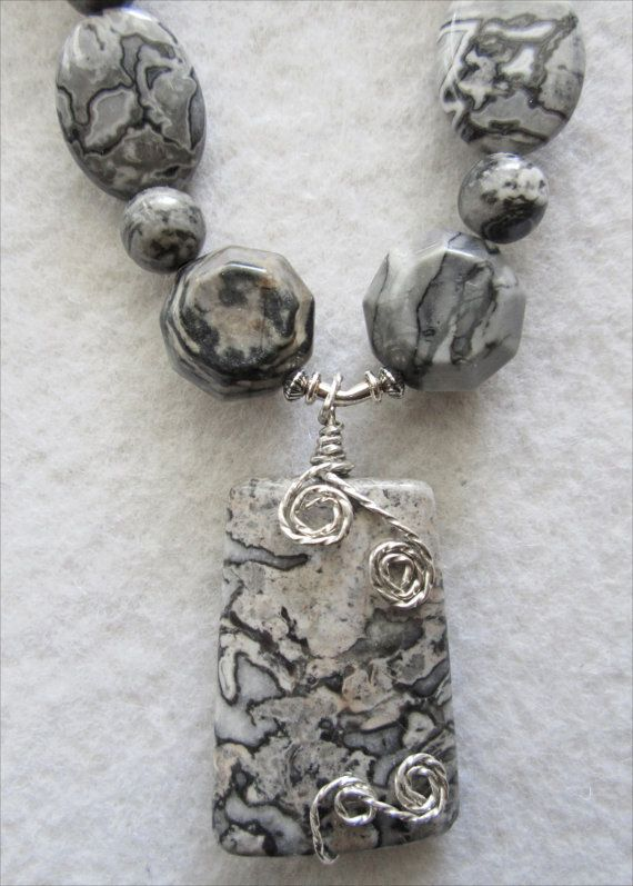 Black & Gray Crazy Lace Pendant and Necklace by MoonbeamsLilacsRoses, $256.00 Varied shapes of GRAY CRAZY LACE AGATE and PICASSO JASPER accentuate the undulating waves that distinguish this interesting and artistic stone. No two stones are alike, and each one displays different variations of the main colors. Designed by Miriam Bat-Rachel.