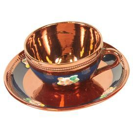 Sarreguemines of France cup and saucer with copper and blue finishes and floral accents. Includes original maker's mark.