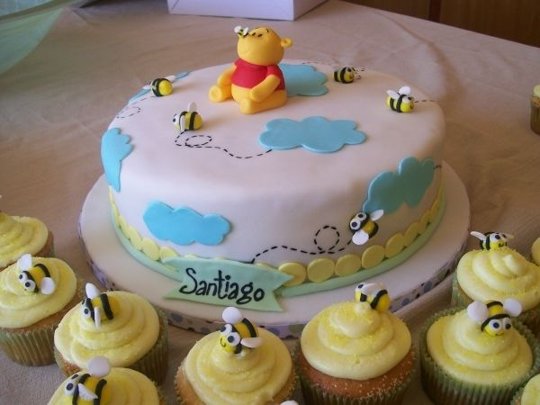 Pooh cake with bee cupcakes