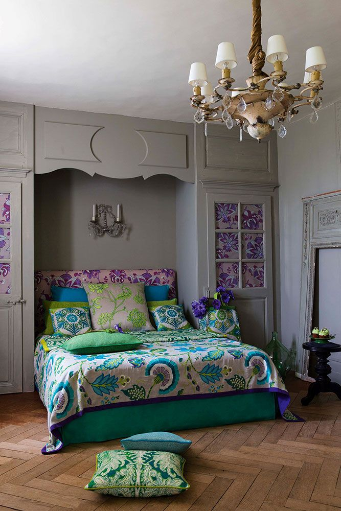 I love Manuel Canovas fabrics from Paris.  Love how French this room feels - the floors, the built-in wall panels, the chandelier.  .Cowan & Tout.