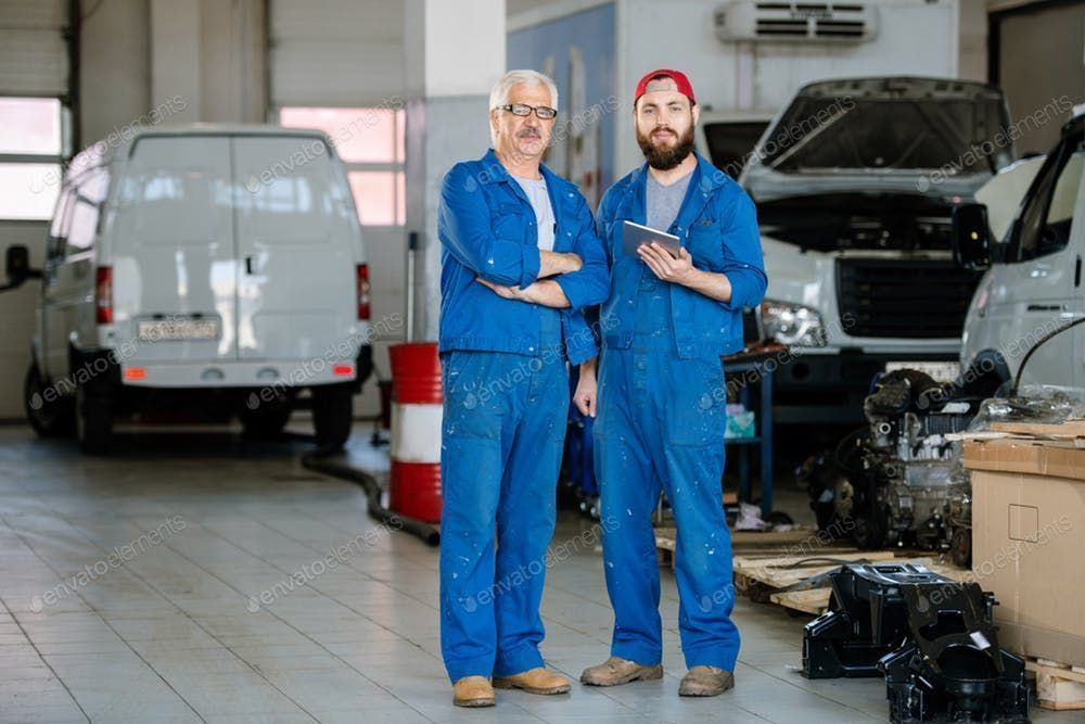 service in blue workwear By Pressmasters photos Two professional technicians of machine repair service in blue workwear By Pressmasters photos professional technicians of...