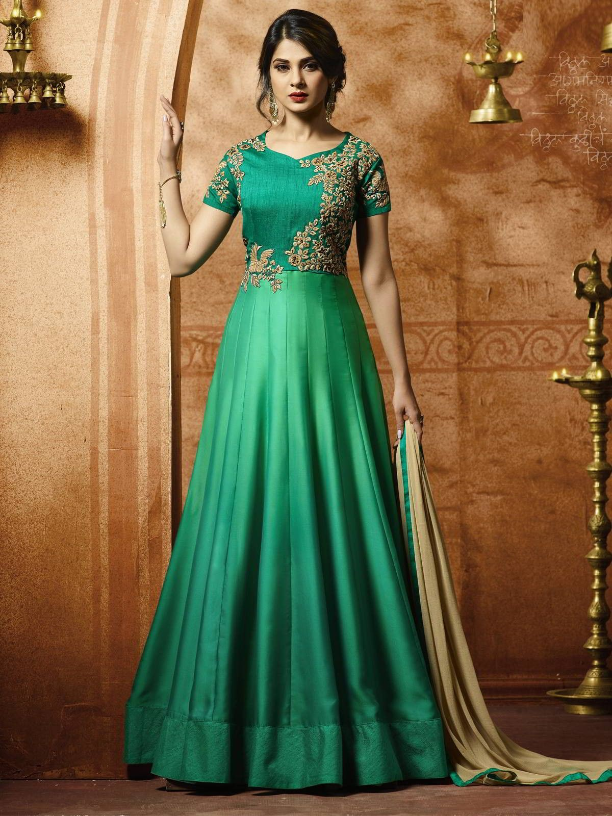 ae8d5143f3 Charming Jennifer Winget green silk gown suit online which is crafted from  silk satin fabric with exclusive resham embroidery work.