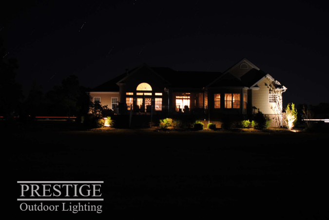 You Don T Need To Light Your Home From Every Angle To Make It Beautiful A Few Strategic Lights Can Wor Landscape Lighting Holiday Lights Outdoor Home Lighting