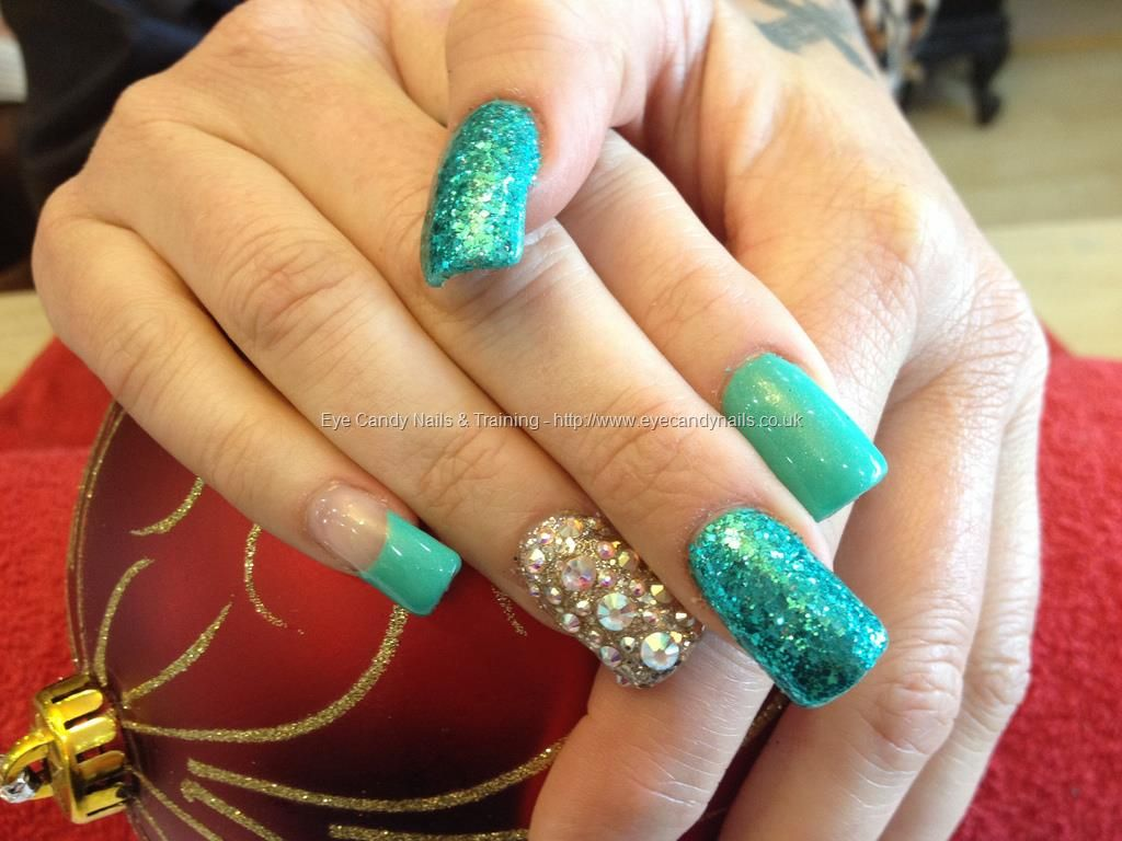 Acrylic nails with green gel polish and glitter