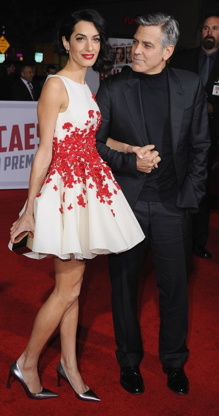 Amal Clooney In a Red & White Floral Giambattista Valli Dress With George Clooney: (http://www.racked.com/2016/2/2/10893520/amal-clooney-hail-caesar)