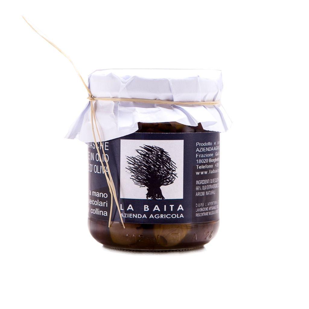 #Olive #Taggiasche #Denocciolate #Sottolio #La #Baita. Le #olive #taggiasche sono tra le varietà di #olive più #pregiate. Di piccole dimensioni, hanno sapore delicato e fruttato e polpa ricca e carnosa.  L'azienda agricola #La #Baita & #Galleano le coltiva nei suoi #uliveti #secolari, tra i più alti della #Liguria, a Gazzo d'Arroscia, un borgo dell'entroterra #imperiese a 700 metri sul mare.