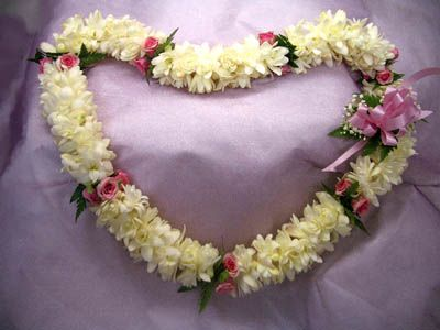 The Tuberose and Roses that grow on the slopes of Haleakala in Kula Maui make for a beautiful Fragrant Lei.