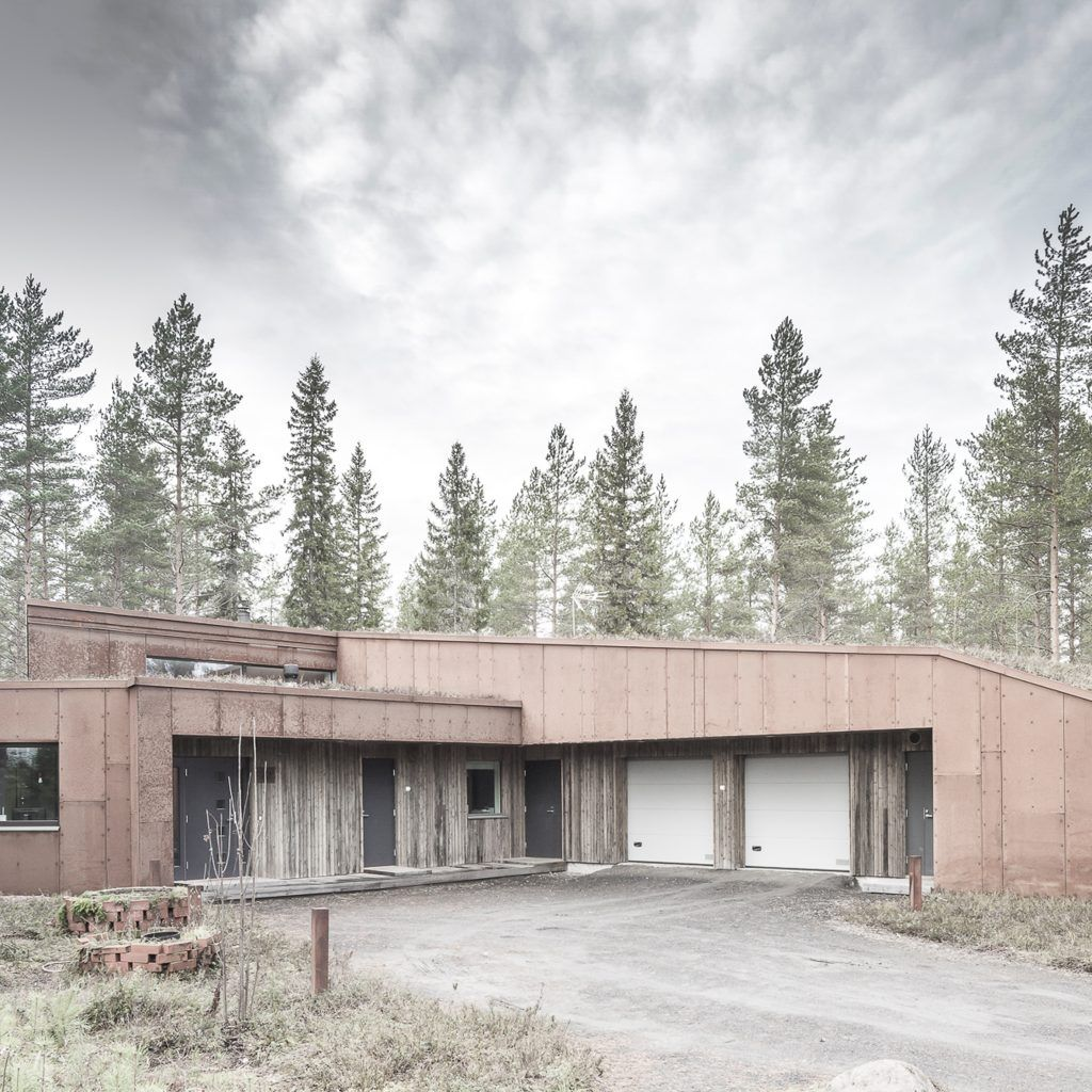 Alt Arkkitehdit clads woodland house in Finland with sheets of rusty Corten steel