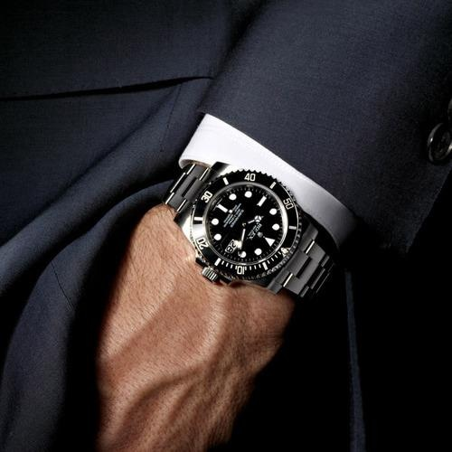 Classic Rolex Submariner. with a suit