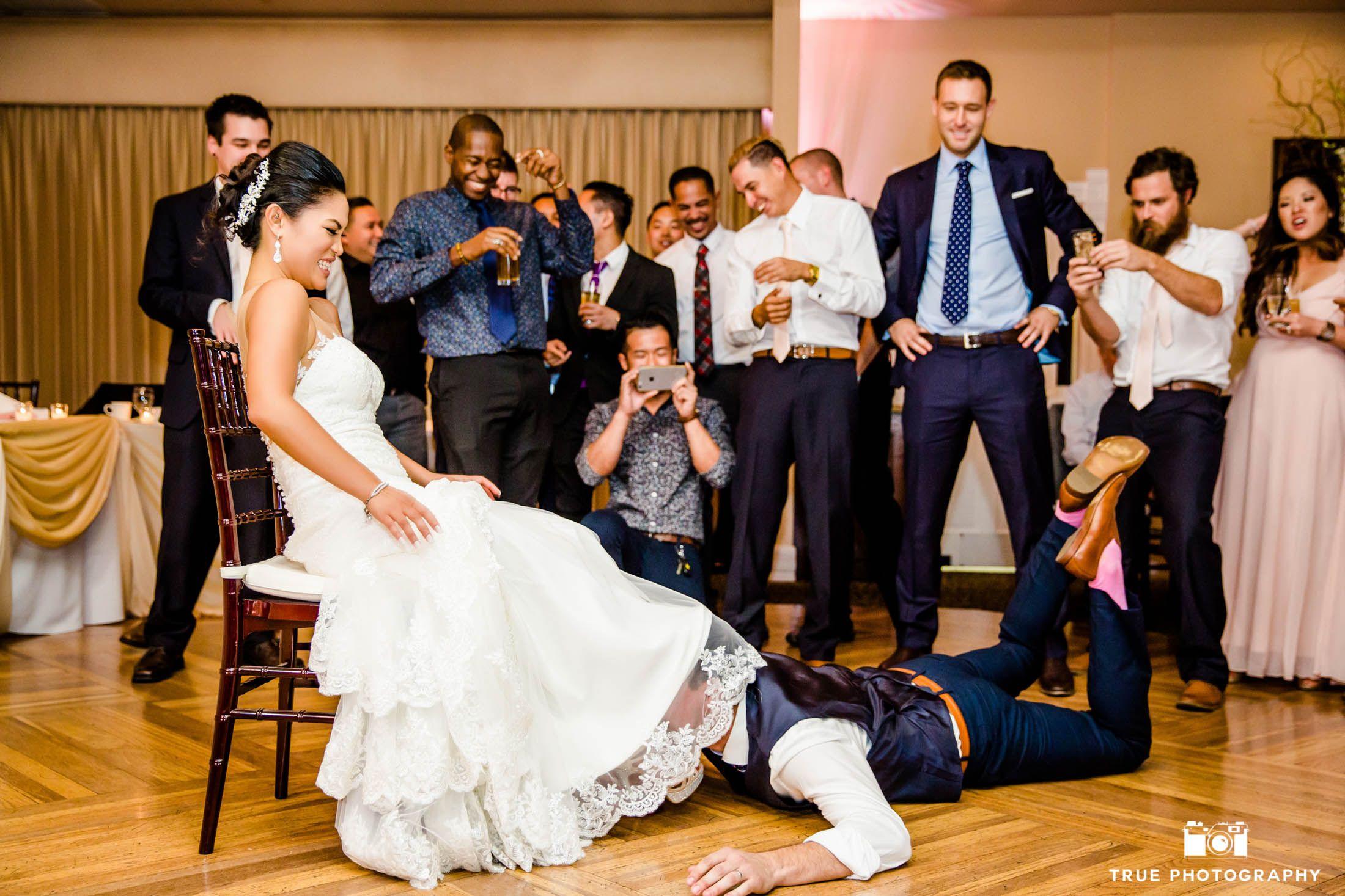 Groom Gets The Garter For The Garter Toss Weddingphotography National Wedding Photographers