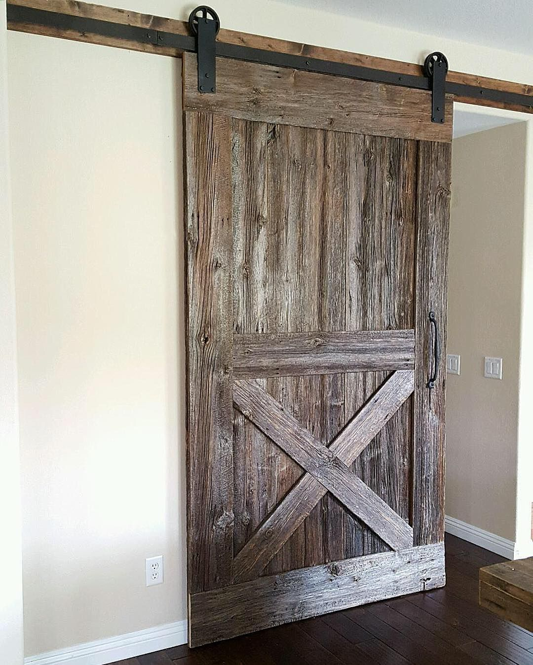 This is from another angle installed yesterday this Reclaimed Barn Door & Hardware for a kitchen.  Love how it has different tones from different angles. #barndoors #barndoor #barndoorhardware #woodwork #woodworking #reclaimedfurniture #reclaimedwood #customwoodwork #customwork #wood #wooddoor #reclaimedbarndoor #reclaimedbarndoors #rusticwoodworking #rusticwoods #rusticwood #rusticfurniture #customwoodworking de barndoorsmoreinc