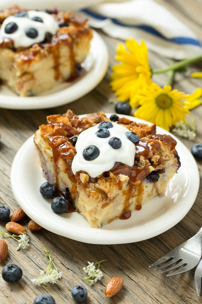 This blueberry almond bread pudding has a streusel topping and is finished off with a drizzle of salted caramel. The ultimate comfort food! Ad