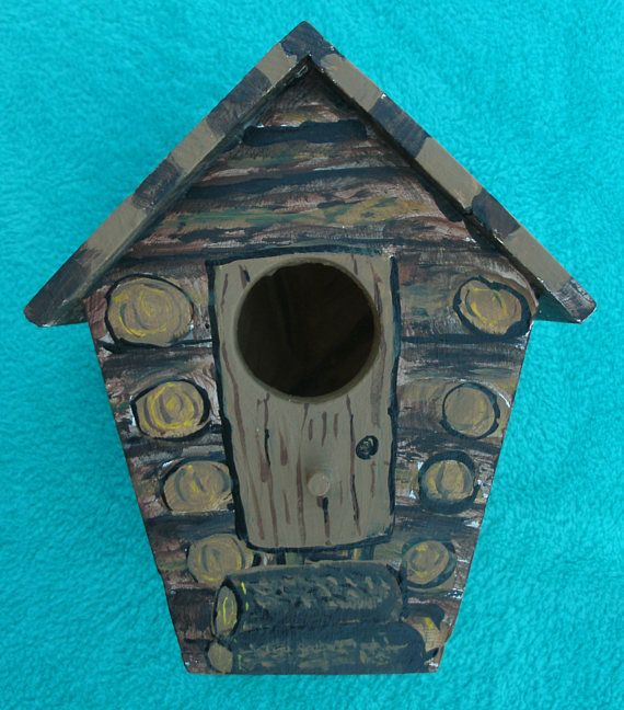 This is a handmade wood bird house that was painted with Acrylic paint. It measures 6.25 inches tall, 5.5 inches wide, and 5.5 inches deep. It is constructed of 1 inch pine board, wood glue, and brads. The roof and floor of the house have been milled down to 1/4 inch. The entrance hole measures 1 1/4 inches. I painted it to look like worn logs. It would be an original gift for a man or a woman. If you would like to have a hanging hook or eye hook added, I will add it at no additiona...
