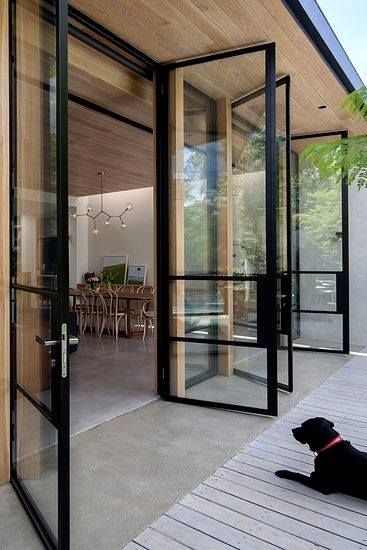 Love concrete floors, indoor/outdoor seamless transition.  Great windows/doors and porch. #metalbarnhomes