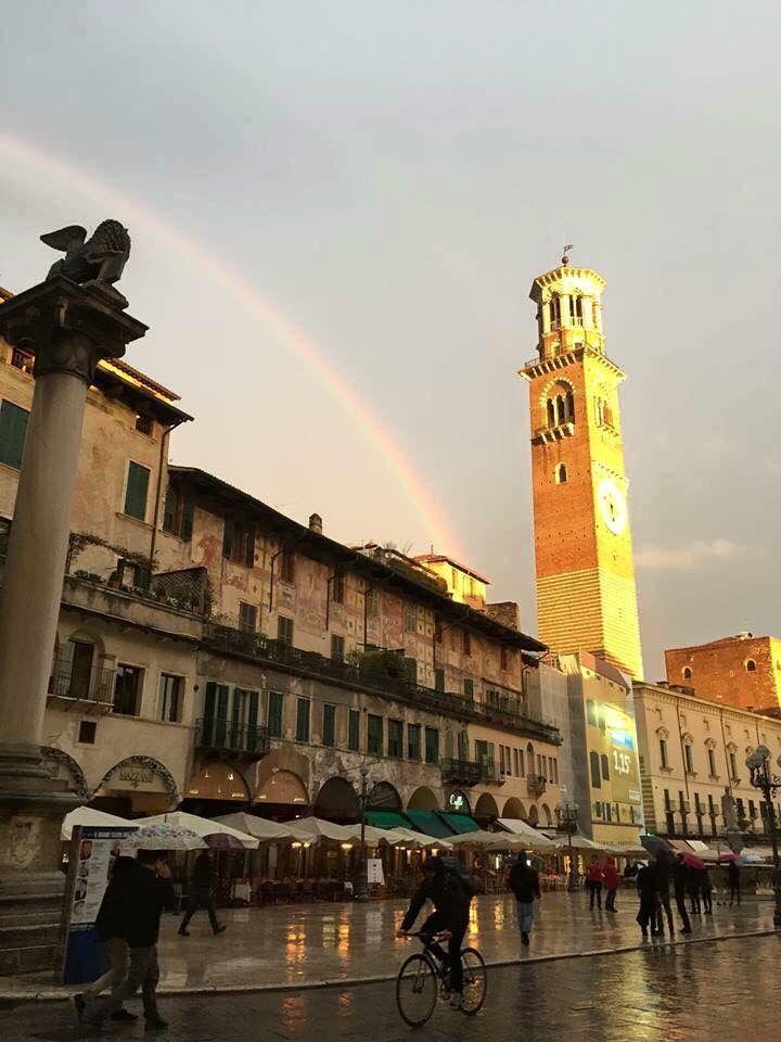 Verona, Italy: Piazza delle Erbe with Torre dei Lamberti enlighted by the sun