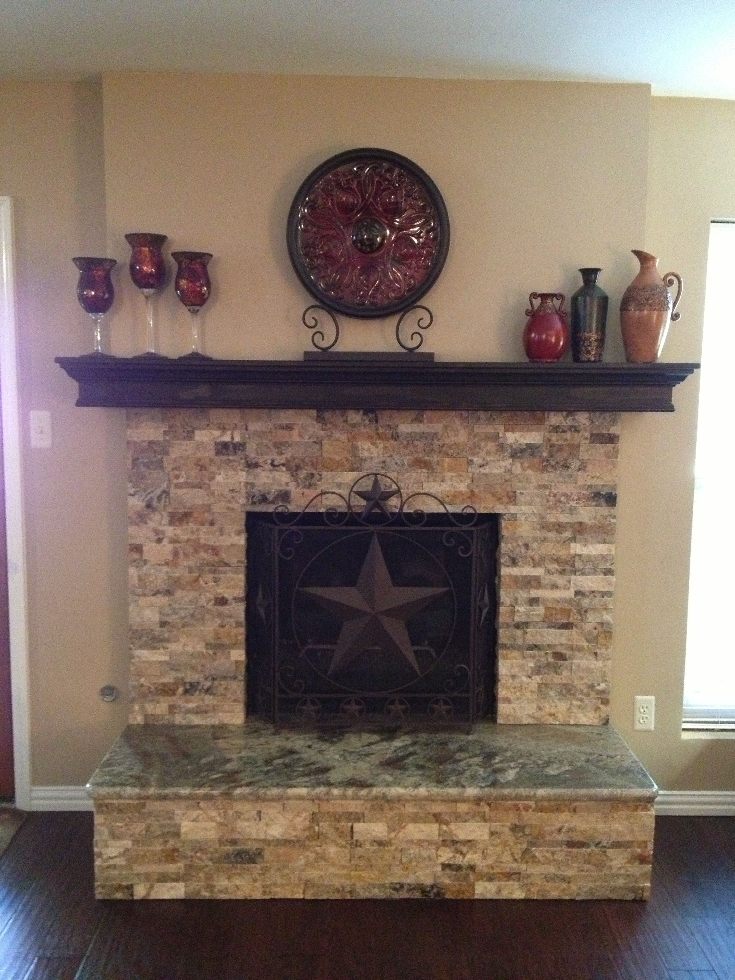 Stacked Stone Fireplace With Granite Hearth