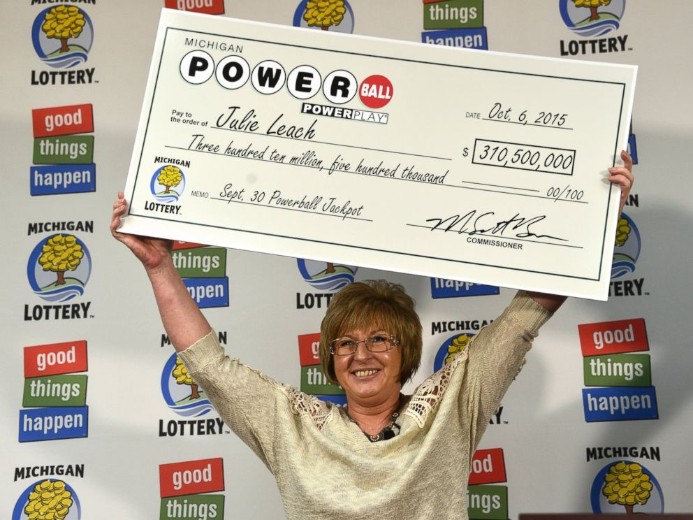 WHAT TO DO IF YOU WIN THE LOTTERY - PHOTO: Julie Leach holds her $310 Million check aloft on Oct. 6, 2015. She was the sole winner of the Powerball jackpot.