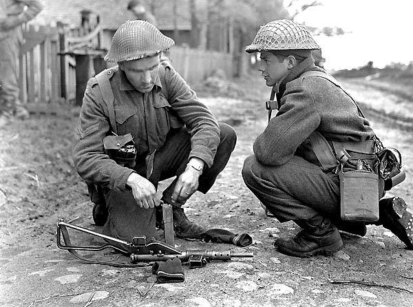 Image result for ww2 british soldier loading a sten gun magazine