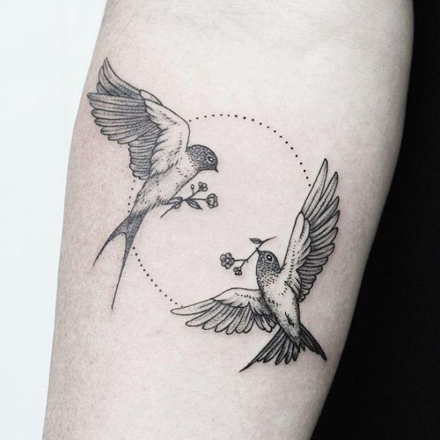 Lovely Black Minimal Tattoo Of Two Birds Carrying Flowers Tattoo Designs Men Circle Tattoos Tattoos