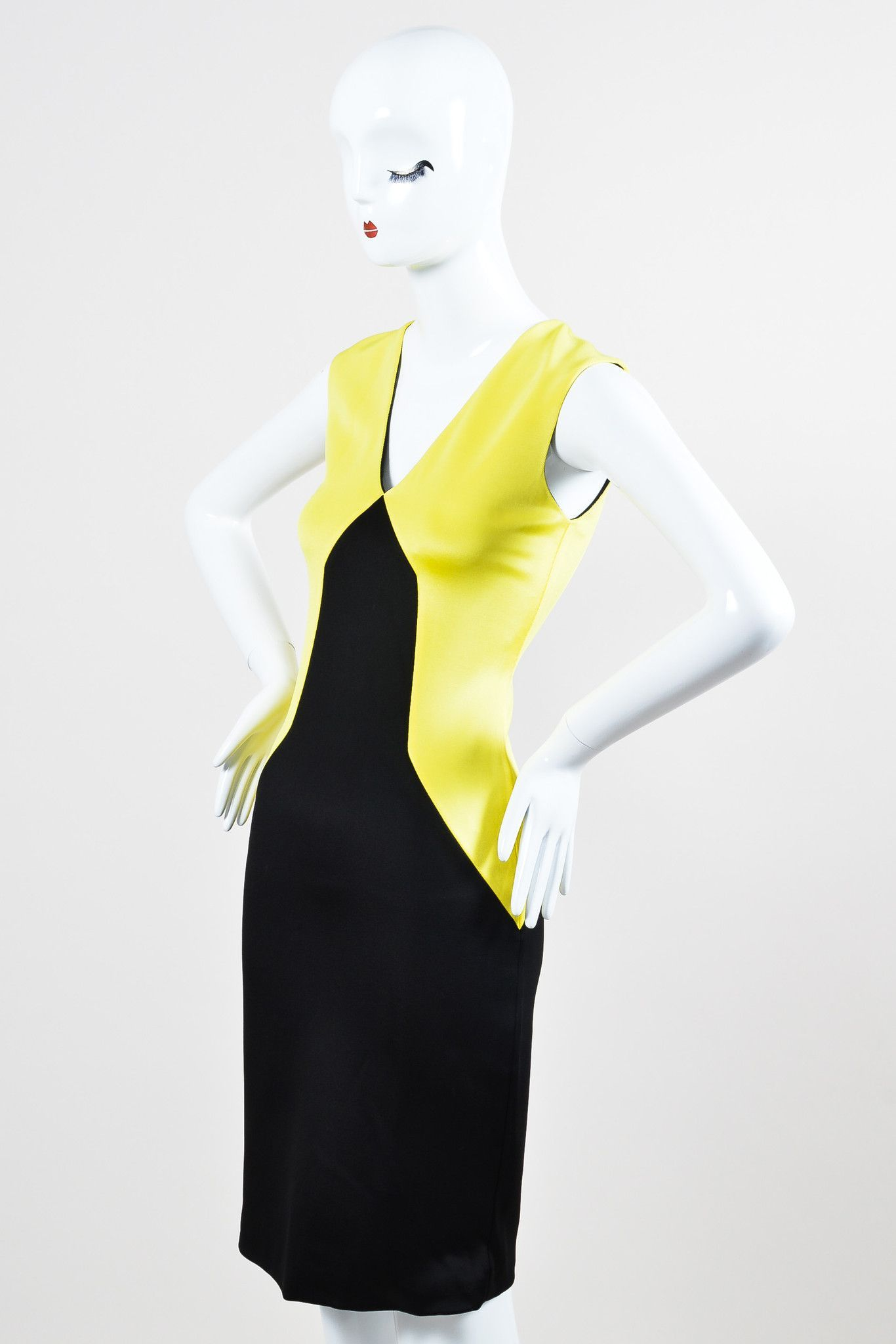 Colorblock sheath dress has black and electric yellow fabric panels. V-neck. Stretch fit. Zip closure down back. Lined. Retails for $950. Size: 4 (USA), 8 (UK), 38 (IT), 34 (FR) Made in: Italy Color: