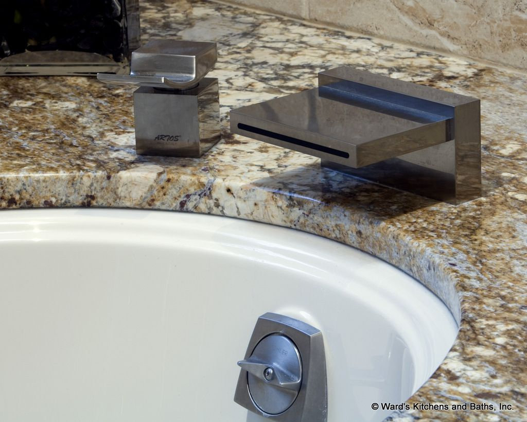 Curved tub deck with toe space lighting, granite tops with ...