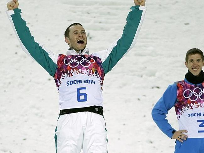 Men's freestyle skiing aerials silver medallist David Morris celebrates as gold medal win