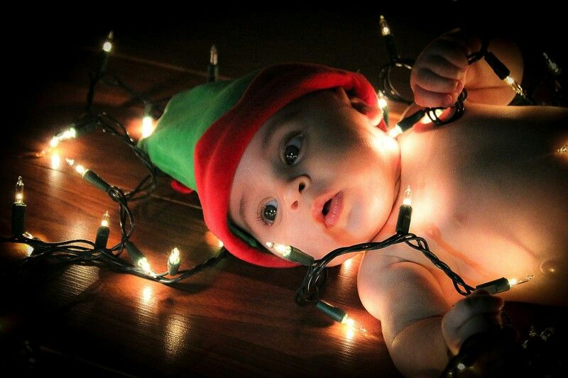 Baby with xmas lights