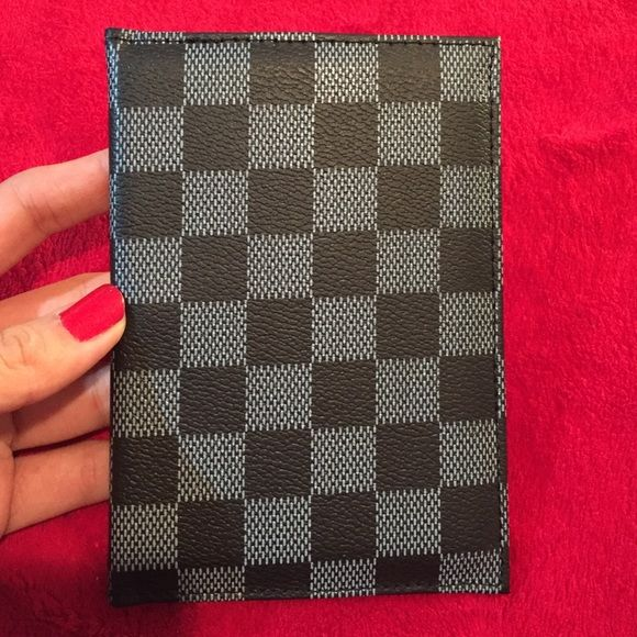 Passport holder It's made by some man-made leather. It is not authentic. Never been used. Make me an offer. Other