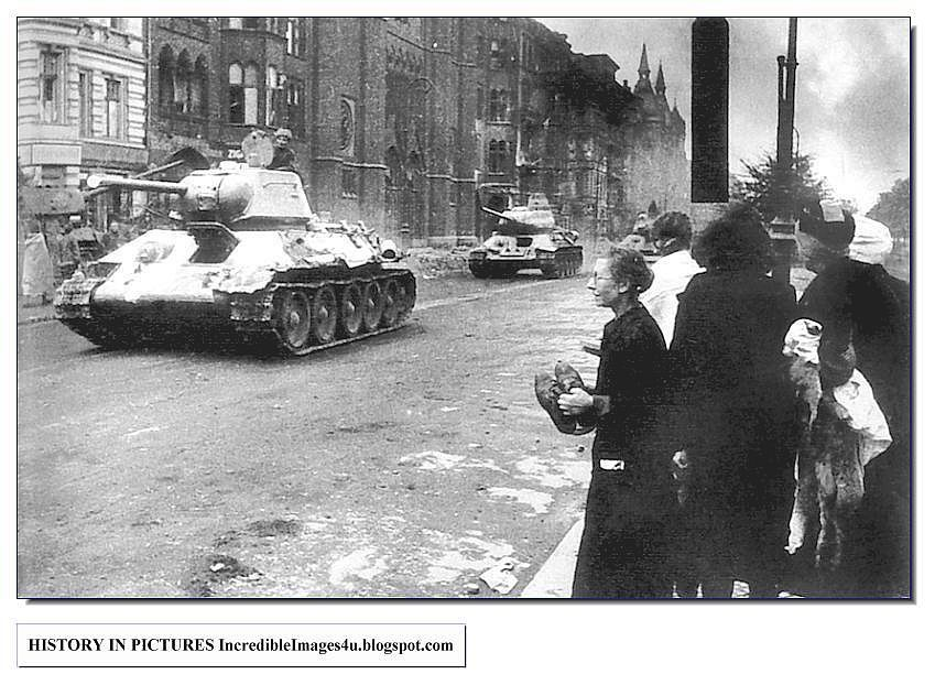 German women watch helplessly as Russian tanks trundle into Berlin