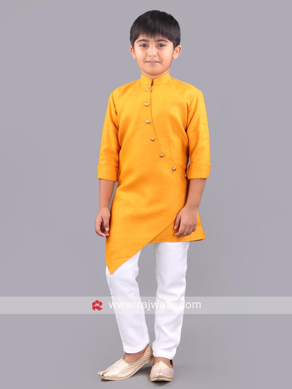 An elegant art silk material kurta in golden yellow color is