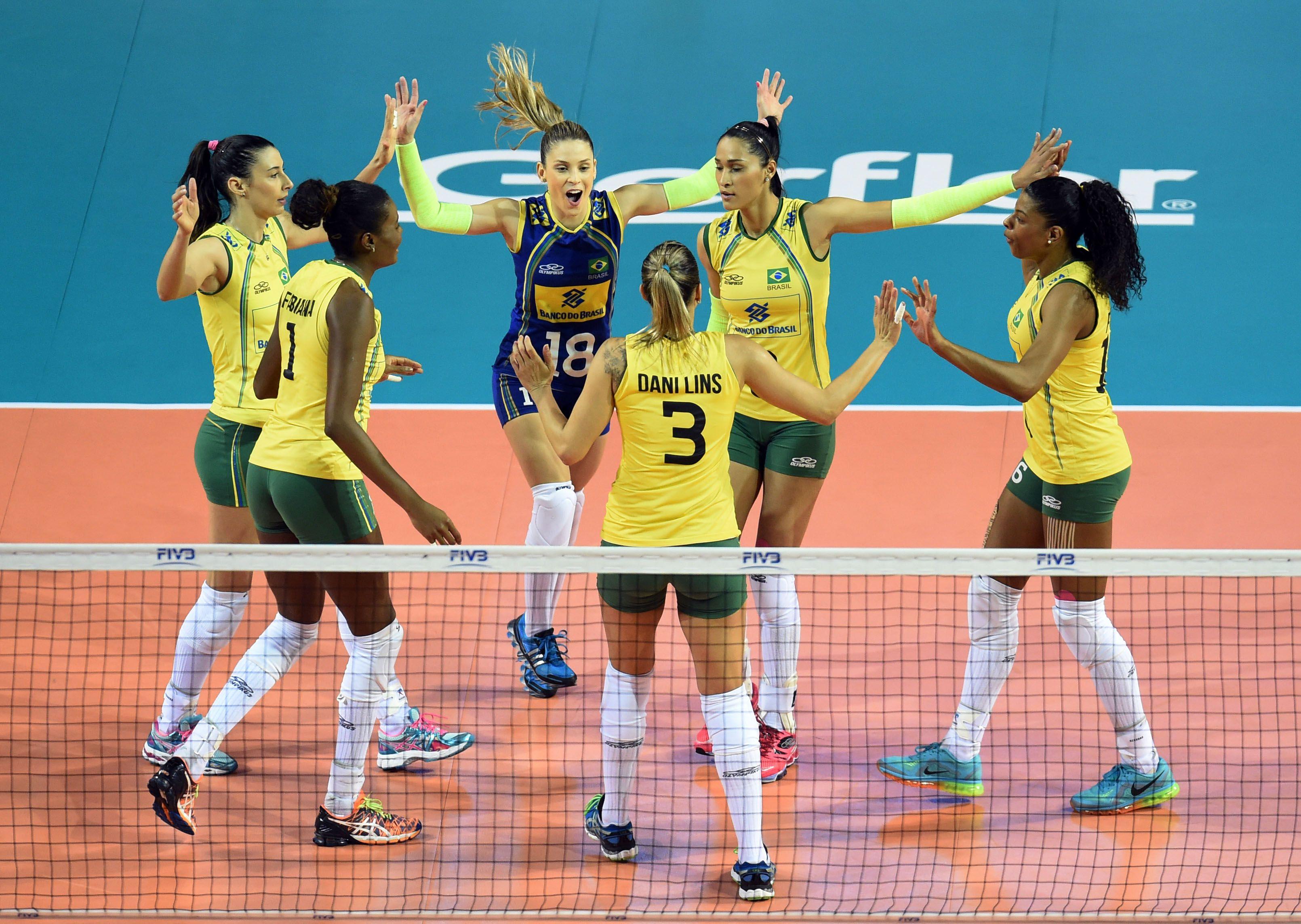 Team Brazil celebrate after winning a point