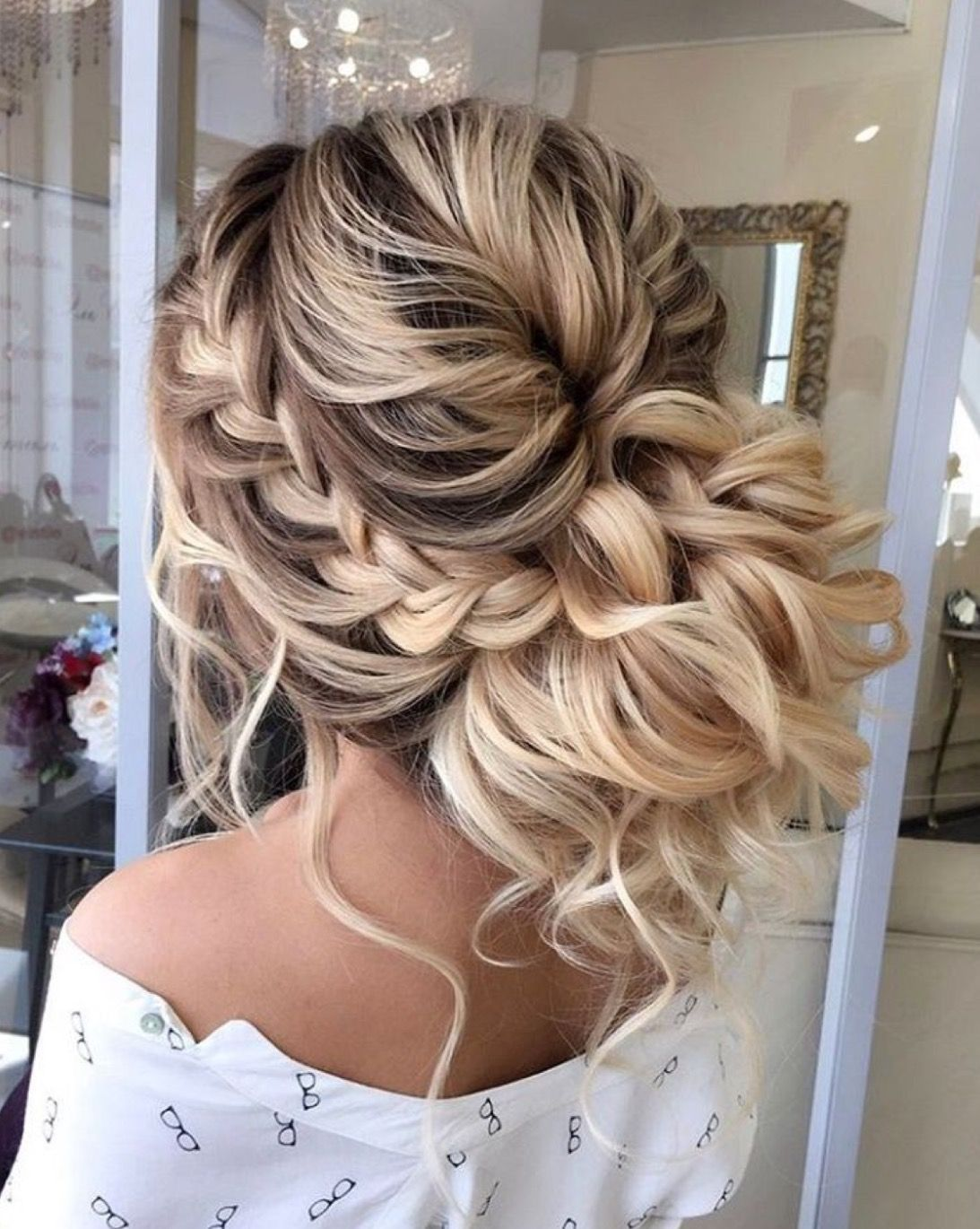 low messy bun updo with curls and a braid-- perfect updo for