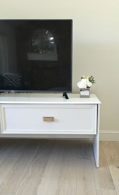 How We Updated Our 1970s House on a Budget.  $20 thrift store find updated into a tv console with laquer paint and new drawer pulls.  Love!