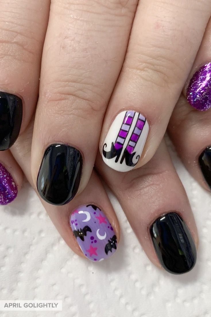 Halloween Nail art with witch legs and shoes and bats with ...